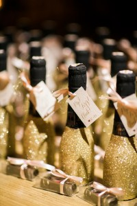 Gold glitter champagne bottles, wedding guest favors, Seattle wedding at Sodo Park, Perfectly Posh Events wedding planning and design, Seattle and Portland Wedding Planner, Photo by Kimberly Kay Photography