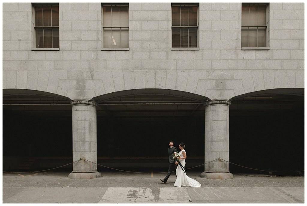 Bride and groom walk through Seattle