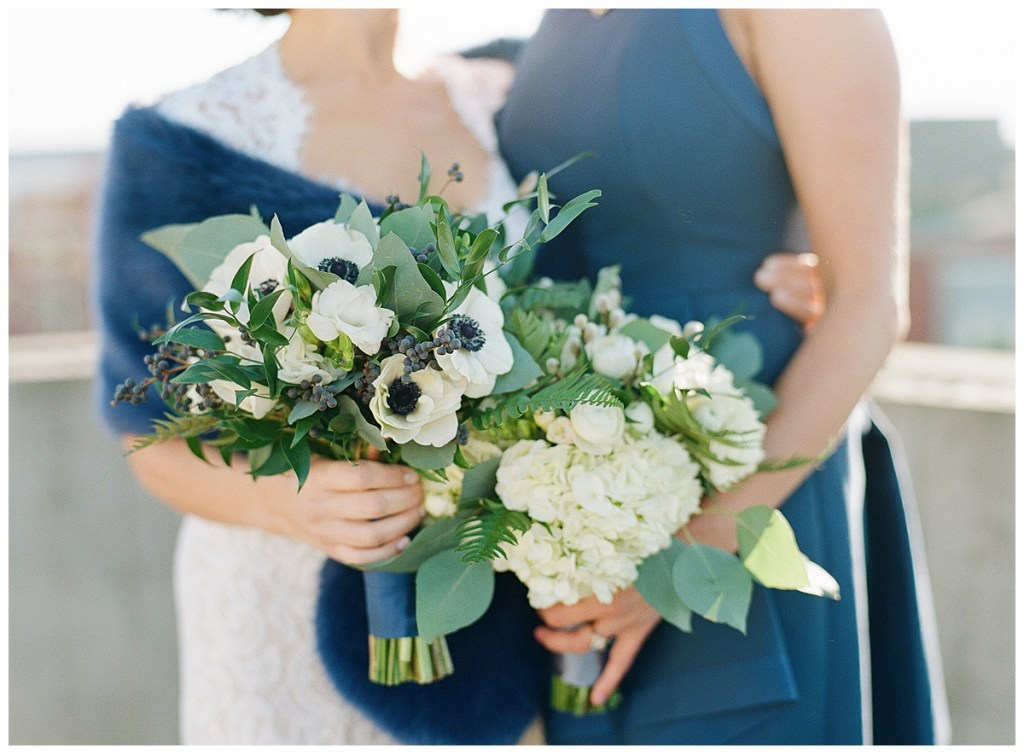 Metropolist Wedding in Seattle, WA | Same sex brides with white and navy bouquets, and other navy accents, like a fur shawl, shoes, and dress | Seattle Wedding Planner, Perfectly Posh Events | Katie Parra Photography | Floral Design by Sublime Stems