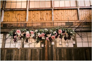 Burgundy, white, and blush wedding floral design featuring white candles hung from ceiling, Seattle wedding at Sodo Park, Perfectly Posh Events wedding planning and design, Seattle and Portland Wedding Planner, Photo by Kimberly Kay Photography