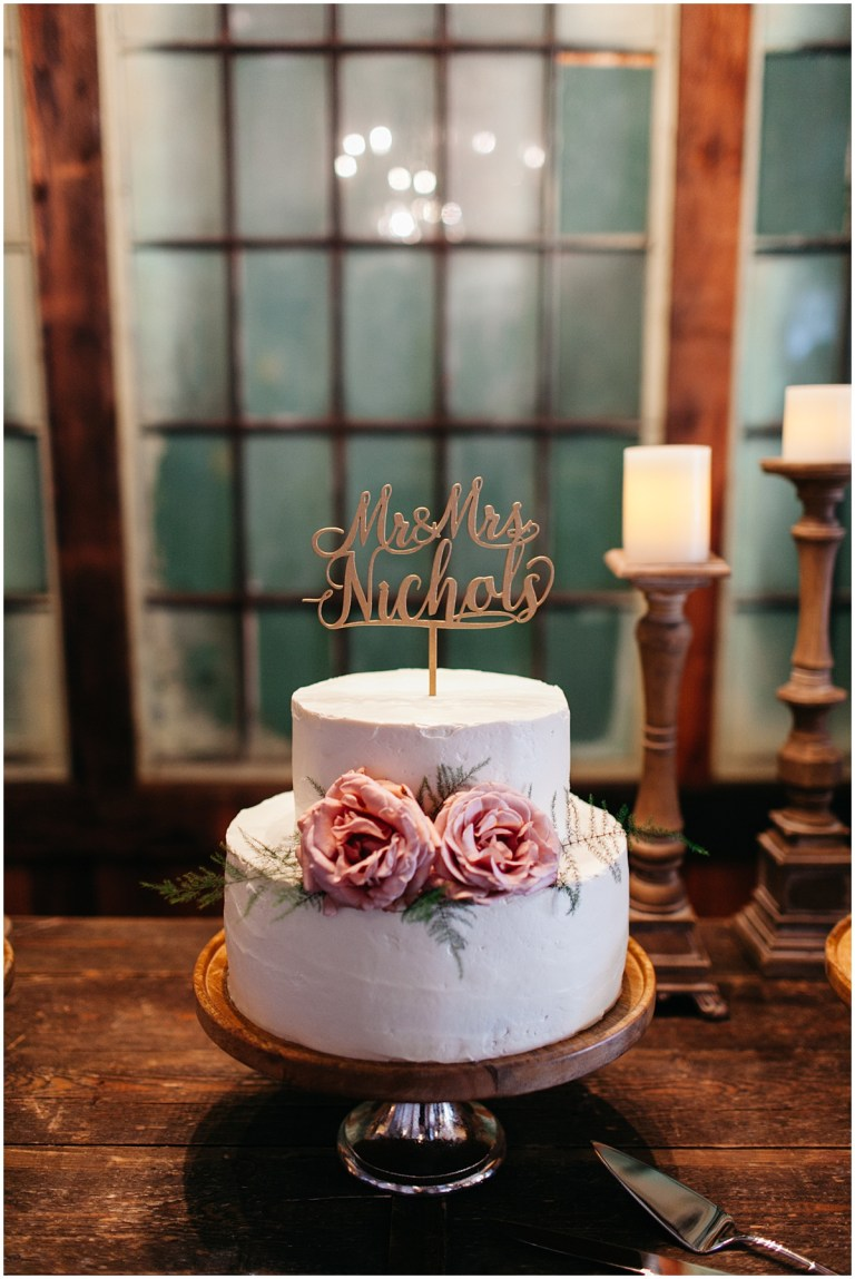 Two tier wedding cake with pink flowers and white frosting, Sodo Park wedding, Seattle wedding, Perfectly Posh Events wedding planning and design, Seattle and Portland Wedding Planner, Photo by Kate Price Photography