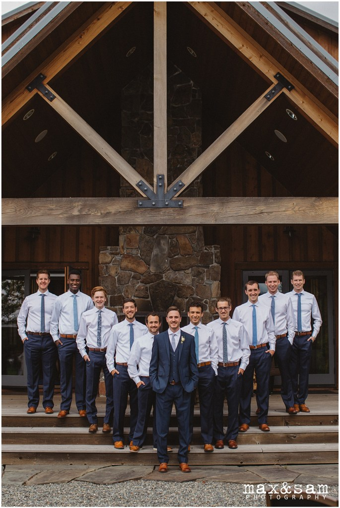 Groom in navy suit poses with groomsmen outside in front of lodge, The Lodge at Fall City wedding, Seattle wedding, planning and design by Perfectly Posh Events, Seattle Wedding Planner, Photo by Max & Sam Photography