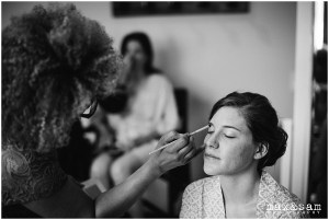 Black and white photo of bride getting her makeup done before her wedding, The Lodge at Fall City wedding, Seattle wedding, planning and design by Perfectly Posh Events, Seattle Wedding Planner, Photo by Max & Sam Photography