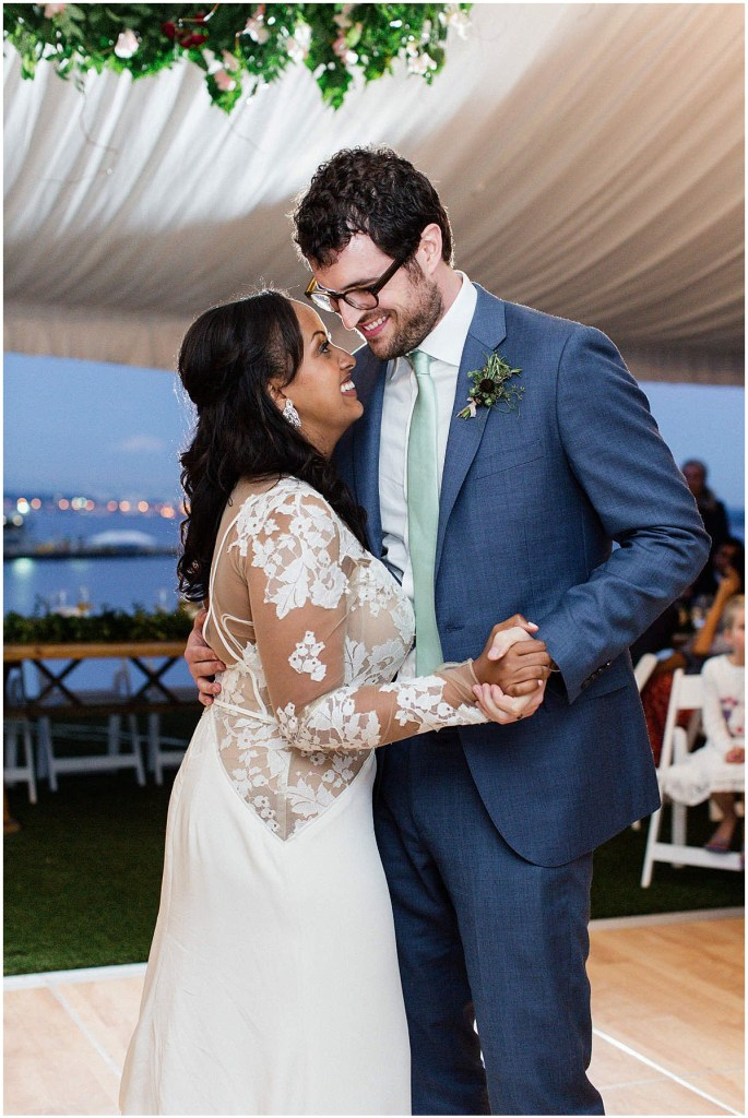 Bride and groom share first dance as a married couple in a white tent at an outdoor reception, Admiral