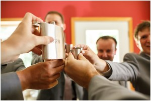 Groom and groomsmen share a pre wedding shot from a monogrammed flask, Kiana Lodge wedding, Perfectly Posh Events wedding planning, Seattle wedding planning, Photo by Amy Soper Photography