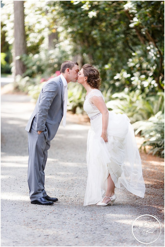 Bride and groom share a kiss outside, Kiana Lodge wedding, Perfectly Posh Events wedding planning, Seattle wedding planning, Photo by Amy Soper Photography