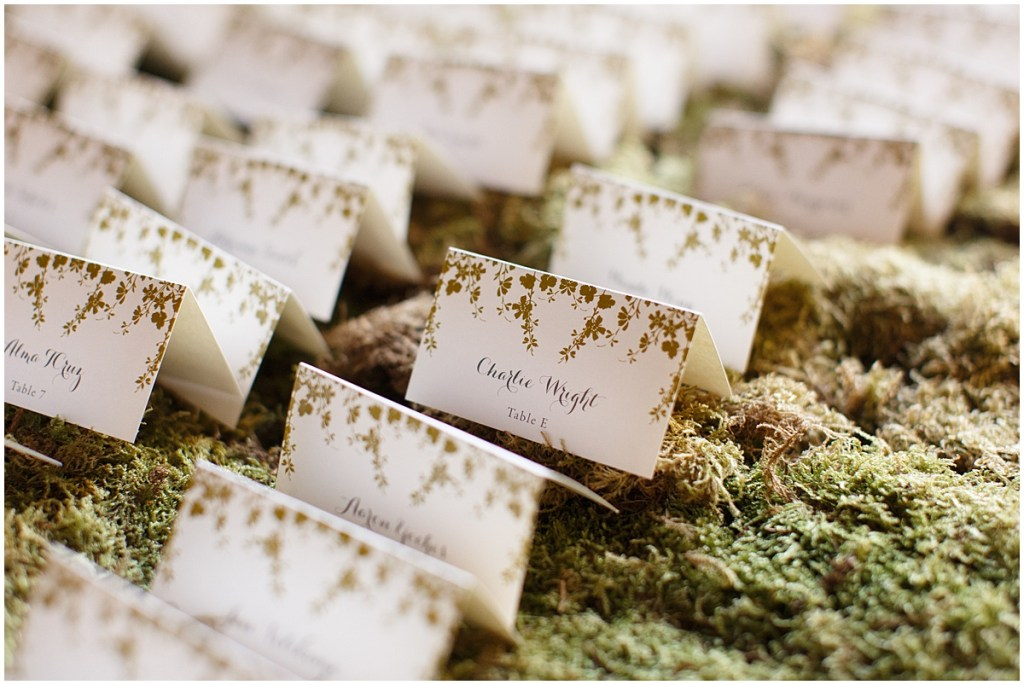 Custom wedding guest table cards sitting on a bed of moss, Kiana Lodge wedding, Perfectly Posh Events wedding planning, Seattle wedding planning, Photo by Amy Soper Photography