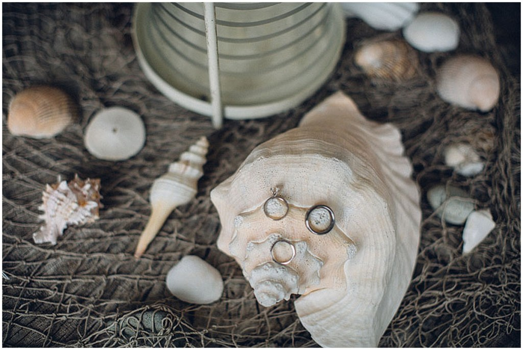 Close up of a bride and grooms wedding bands and engagement ring resting on seashells, Washington wedding, Perfectly Posh Events wedding planning, Washington wedding planning and coordination, Photo by Mike Fiechtner Photography