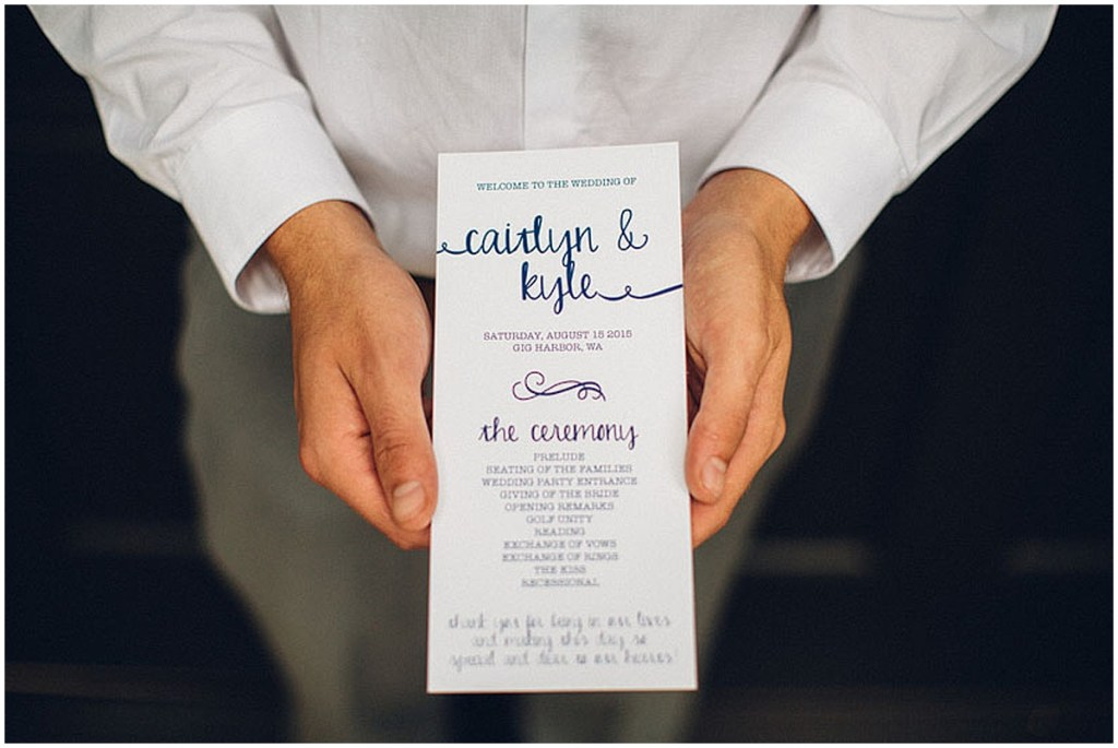 A groomsman holds custom designed wedding ceremony program, Washington wedding, Perfectly Posh Events wedding planning, Washington wedding planner, Photo by Mike Fiechtner Photographyv
