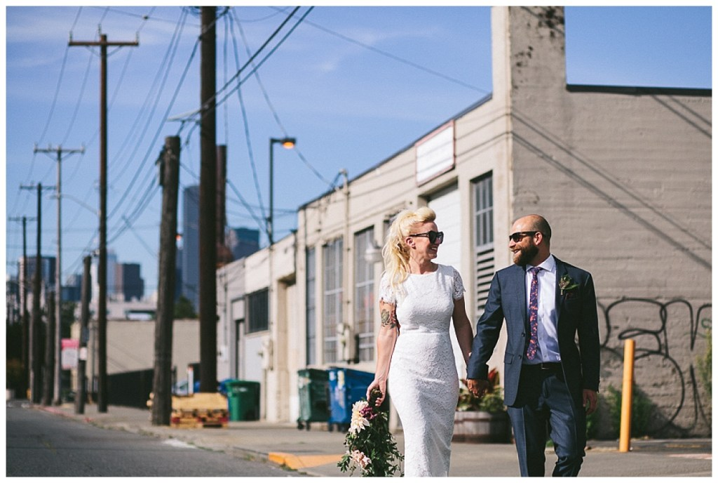 Edgy bride and groom walk into their wedding venue downtown Seattle with a cascading bouquet and sunglasses | Within Sodo, Seattle Washington | Perfectly Posh Events, Seattle and Portland Event Coordinators
