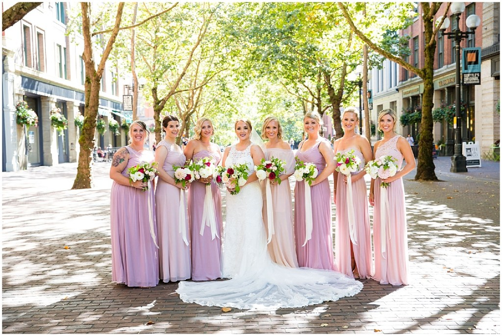 Bride poses with her bridesmaids in blush and pink gowns in Pioneer Square, Sodo Park wedding, Seattle wedding planner, Perfectly Posh Events, Photo by La Vie Photography