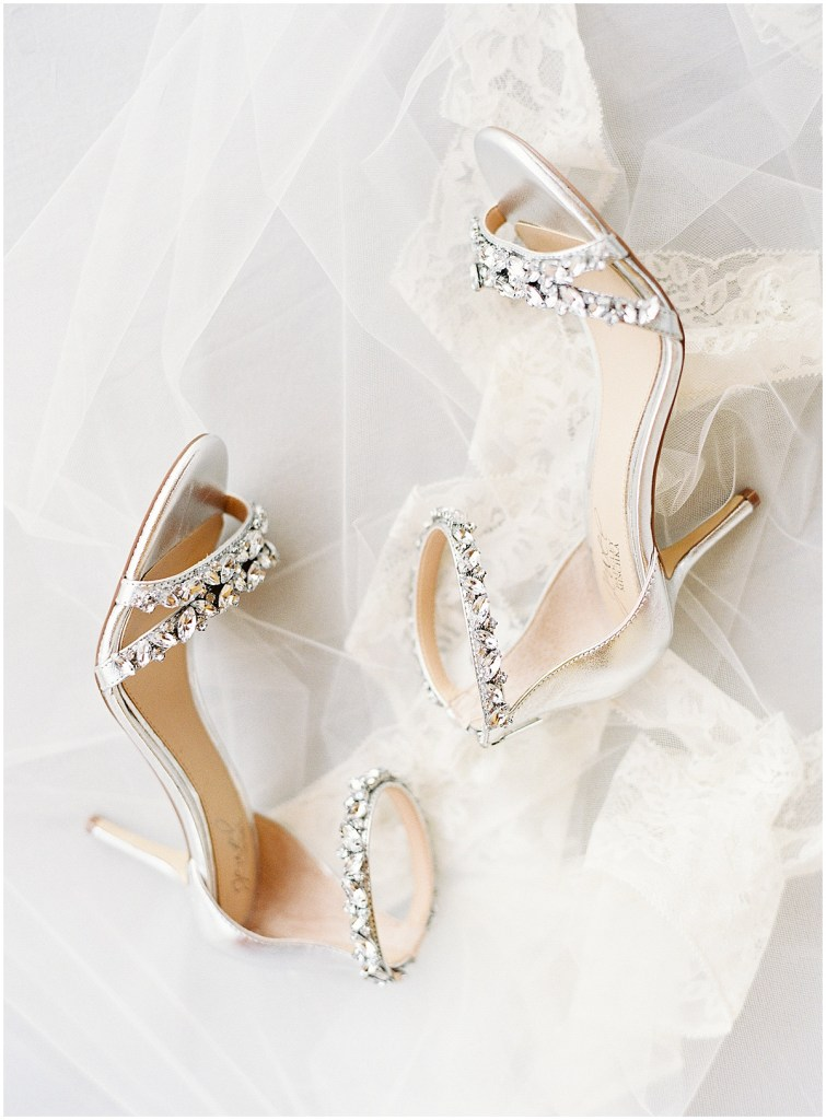 Bejeweled silver heels with straps sit on a long sheer bridal veil, DeLille Cellars wedding, Woodinville wedding, Perfectly Posh Events wedding coordination, Photo by Great Romance Photography