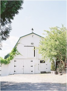 White barn partially covered in vines, DeLille Cellars wedding, Woodinville wedding, Perfectly Posh Events wedding coordination, Photo by Great Romance Photography