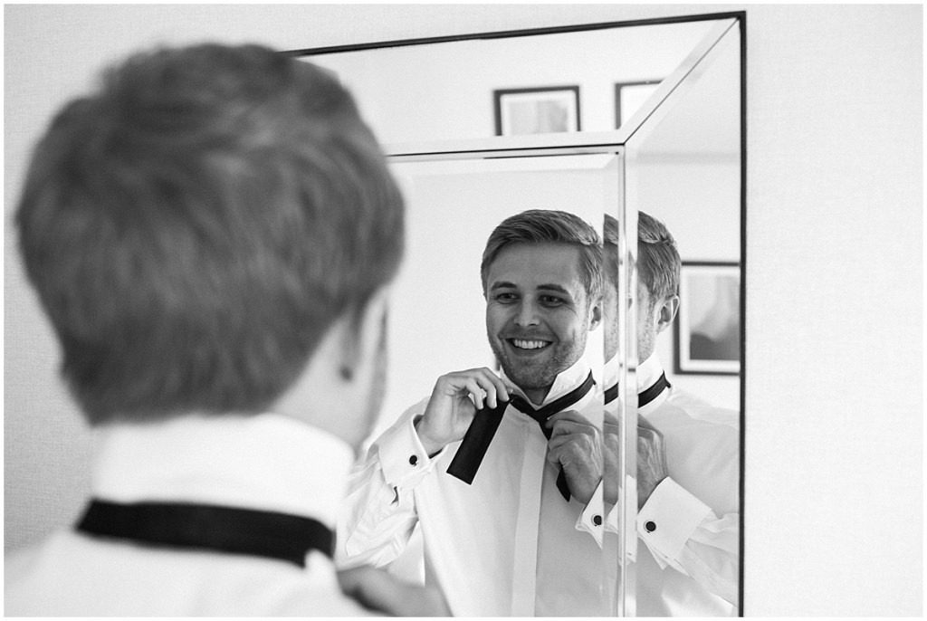 Black and white photo of groom looking into mirror while tying a bowtie, DeLille Cellars wedding, Washington wedding planner, Perfectly Posh Events, Photo by Shane Macomber Photography