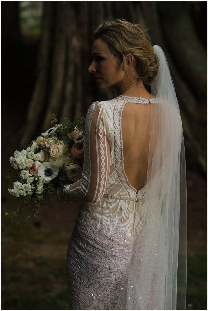 Back view of a bride wearing a beaded backless gown and a long, sheer veil, DeLille Cellars wedding, Washington wedding planner, Perfectly Posh Events, Photo by Shane Macomber Photography