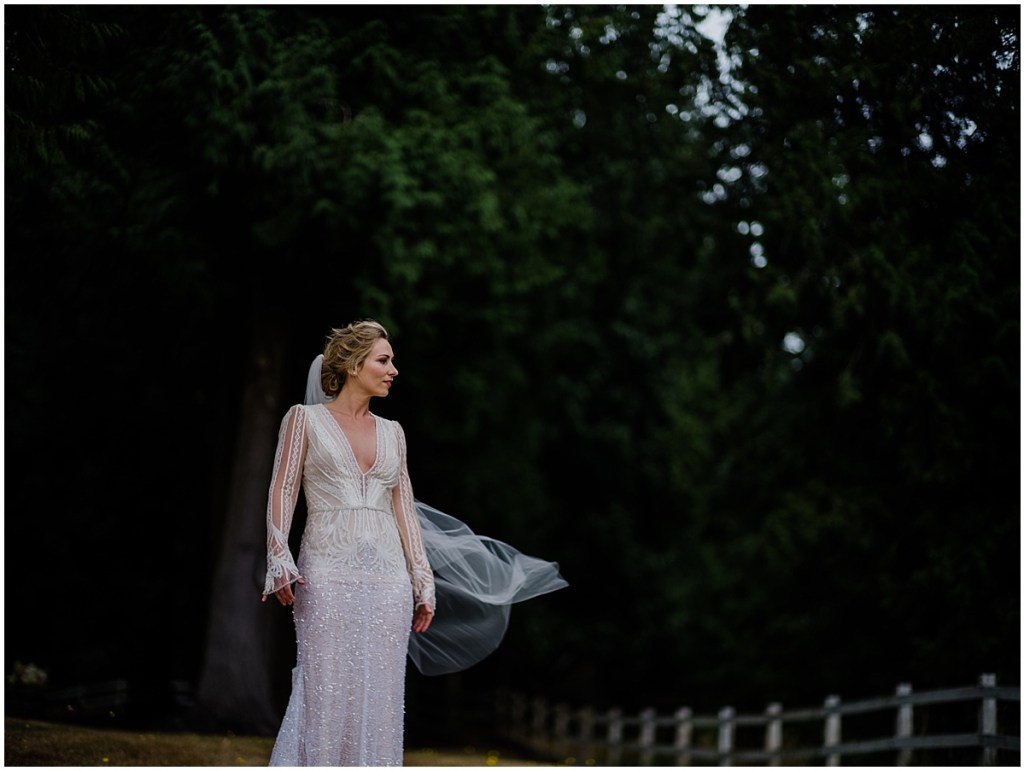 Bride poses outside while her long veil floats in the breeze, DeLille Cellars wedding, Washington wedding planner, Perfectly Posh Events, Photo by Shane Macomber Photography
