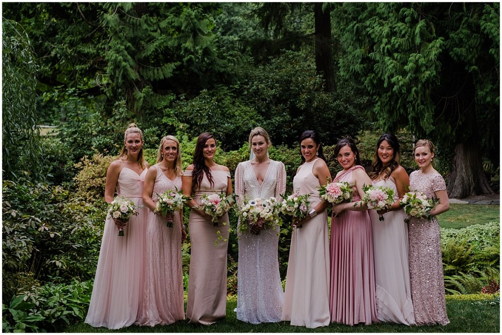 Bride poses outside with her bridesmaids wearing a mix of blush colored gowns, DeLille Cellars wedding, Washington wedding planner, Perfectly Posh Events, Photo by Shane Macomber Photography