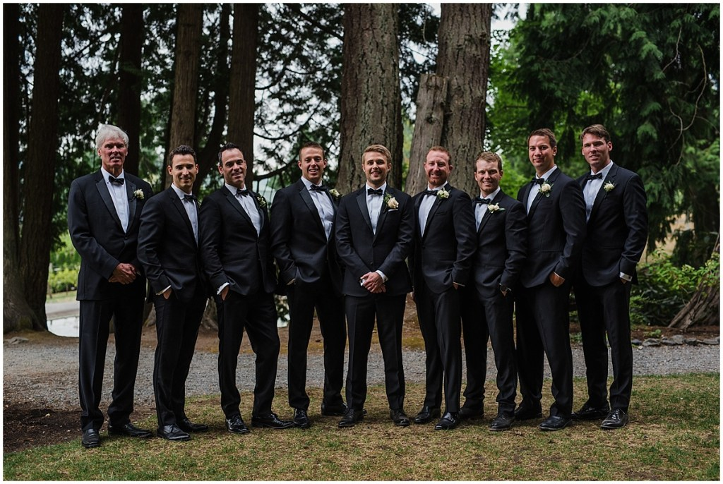 Groom poses under pine trees with his groomsmen wearing classic black tuxedos, DeLille Cellars wedding, Washington wedding planner, Perfectly Posh Events, Photo by Shane Macomber Photography