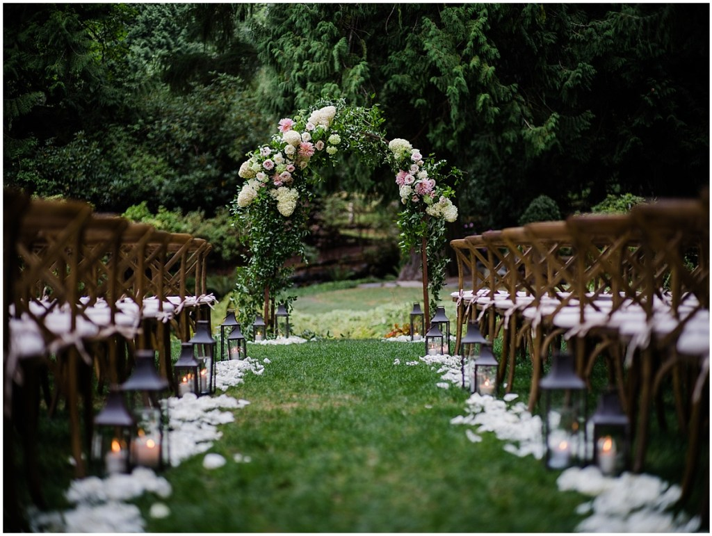 Outdoor wedding ceremony set up with rustic wood chairs and an altar covered with ivory and blush colored flowers and plenty of vines, DeLille Cellars wedding, Washington wedding planner, Perfectly Posh Events, Photo by Shane Macomber Photography