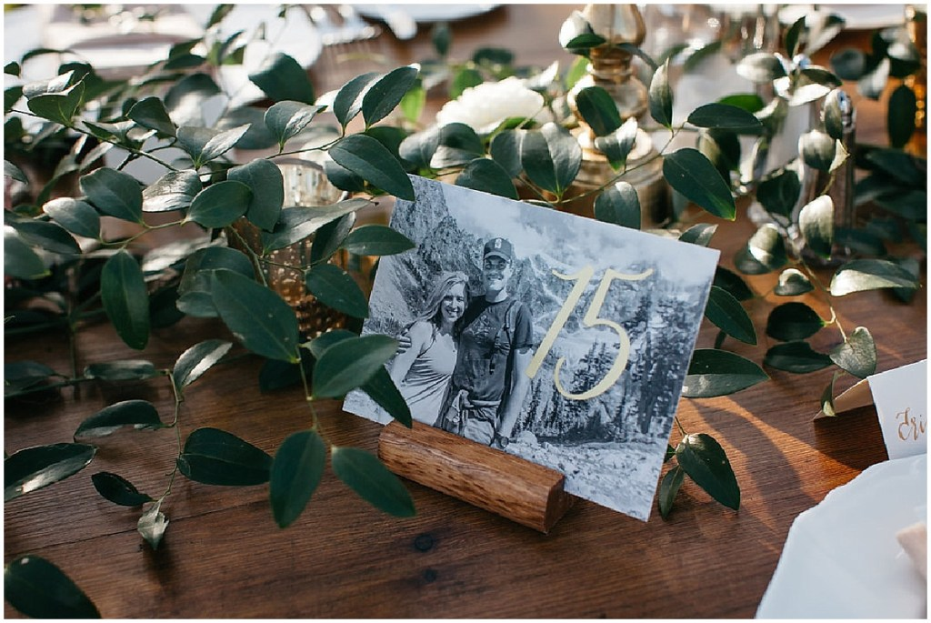 Custom made wedding table number featuring gold lettering on a black and white photo of the bride and groom, PNW outdoor summer wedding, Washington wedding designer, Perfectly Posh Events, Photo by Kate Price Photography