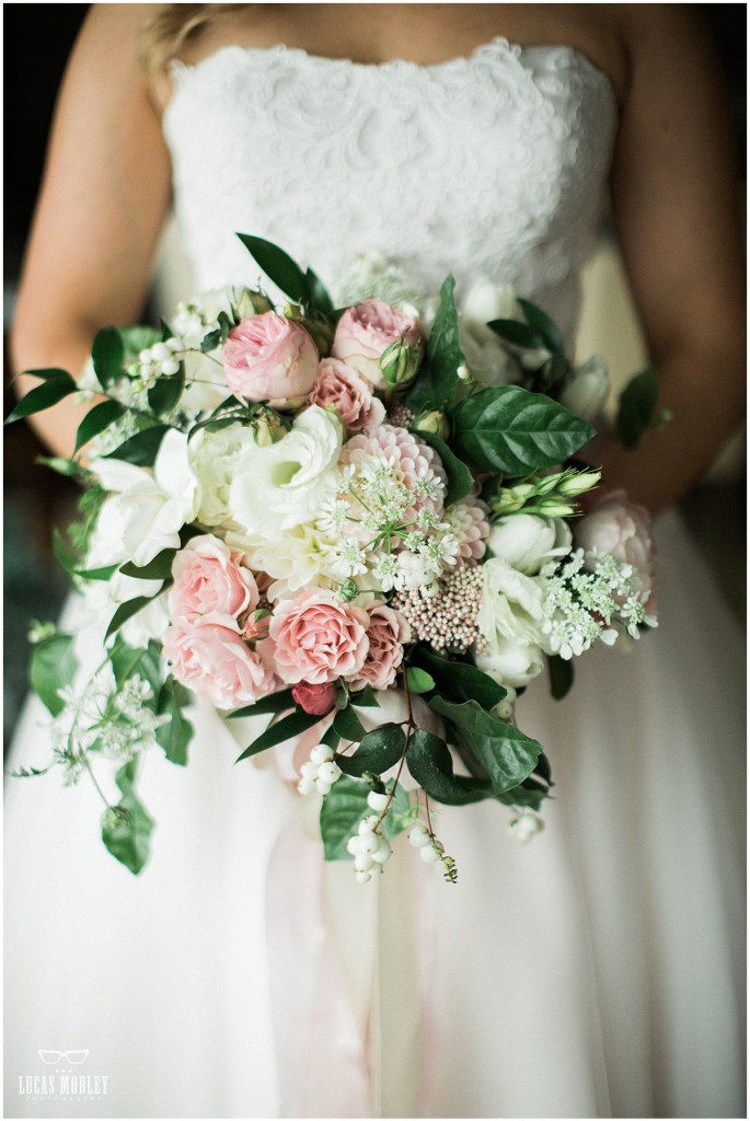 Close up of bride holding floral bouquet made of ballerina pink and ivory flowers with pops of greenery, The Foundry by Herban Feast wedding, fall wedding, Seattle wedding planner, Perfectly Posh Events, Photo by Lucas Mobley Photography
