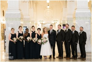 Bride and groom pose with their bridesmaids and groomsmen inside downtown Seattle's King Street Station, The Foundry by Herban Feast wedding, fall wedding, Seattle wedding planner, Perfectly Posh Events, Photo by Lucas Mobley Photography