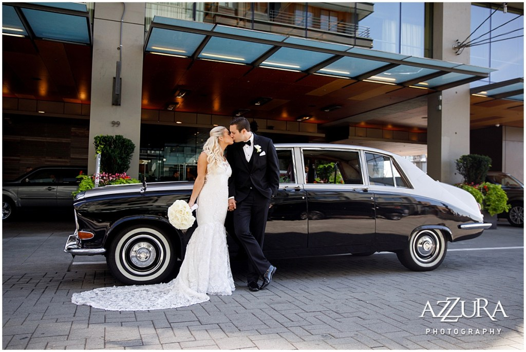 Bride and groom share a kiss while standing in front of a vintage Rolls Royce, Four Seasons wedding, Seattle wedding, Perfectly Posh Events event coordination, Photo by Azzura Photography