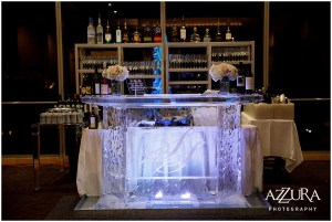 A custom made bar made completely of ice and etched with the bride and groom's initials serves as a fully stocked bar for wedding guests, Four Seasons wedding, Seattle wedding, Perfectly Posh Events event coordination, Photo by Azzura Photography