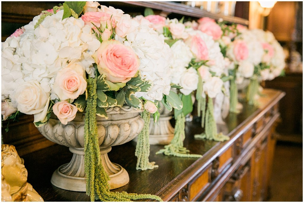 Large concrete urns hold floral bouquets overflowing with ivory and blush pink flowers with touches of greenery, Pacific Northwest wedding, Thornewood Castle wedding, wedding planning by Perfectly Posh Events, Photo by Stephanie Cristalli