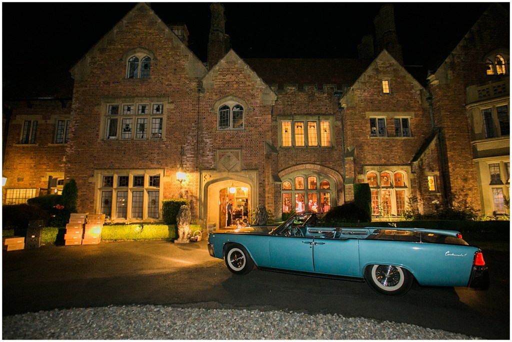 A vintage teal blue Cadillac convertible sits in front of Thornewood Castle for the bride and groom's getaway car, Pacific Northwest wedding, Thornewood Castle wedding, wedding planning by Perfectly Posh Events, Photo by Stephanie Cristalli
