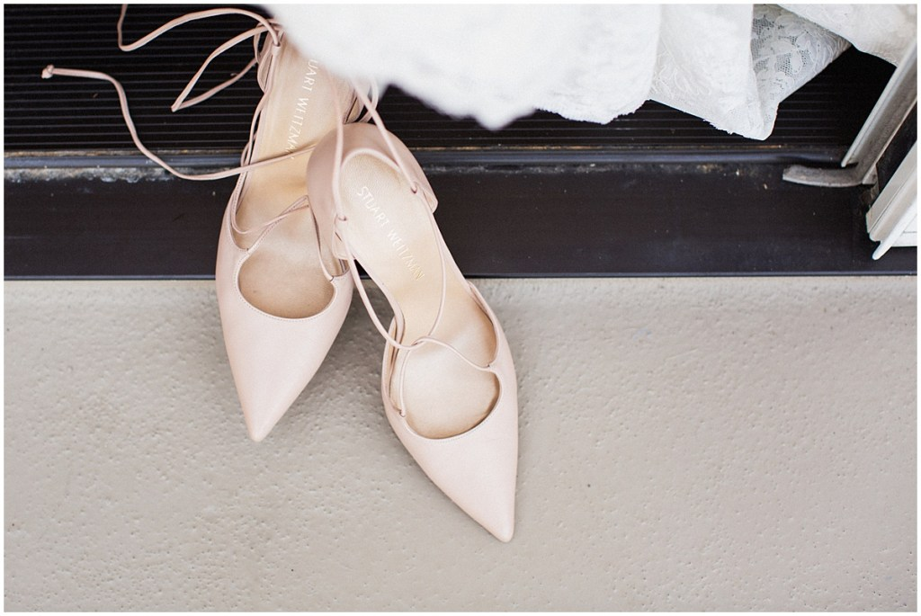 Close up of a bride's blush colored, pointed toe Stuart Weitzman with tie up straps, urban wedding, Within Sodo wedding, Seattle event planner, Perfectly Posh Events, Photo by Jenny J Photography
