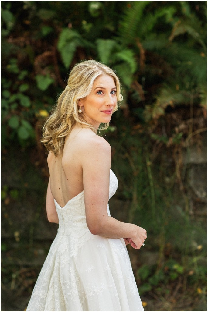 Bride in an off-white strapless gown poses outside, urban wedding, Within Sodo wedding, Seattle event planner, Perfectly Posh Events, Photo by Jenny J Photography