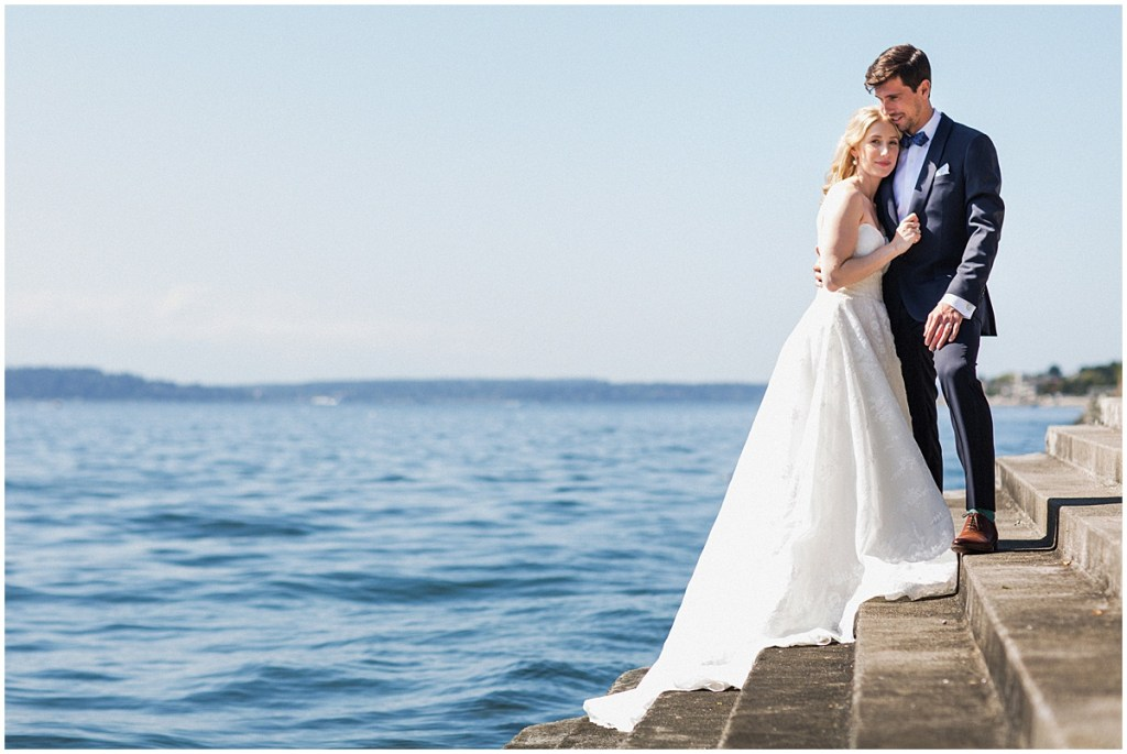 Bride and groom pose outside on steps leading to the waters of Puget Sound, urban wedding, Within Sodo wedding, Seattle event planner, Perfectly Posh Events, Photo by Jenny J Photography