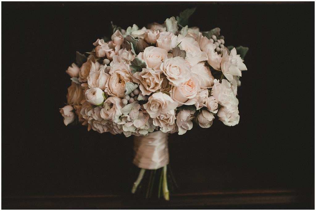 A large bridal bouquet with white, ivory, and cream colored flowers, Edgewater Hotel, Seattle wedding, Washington wedding coordinator, Perfectly Posh Events, Photo by Carina Skrobecki