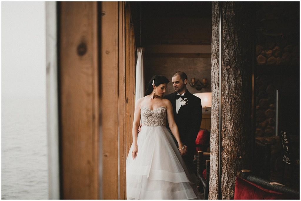 Bride and groom posing inside the Edgewater hotel with a view of Elliott Bay, Edgewater Hotel, Seattle wedding, Washington wedding coordinator, Perfectly Posh Events, Photo by Carina Skrobecki