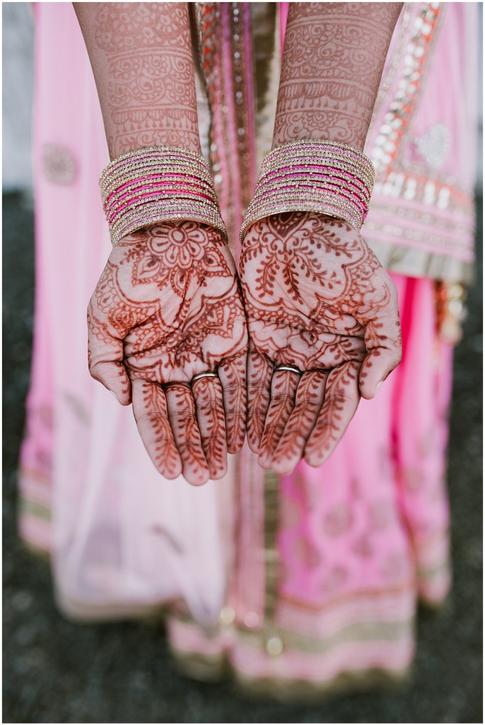 Close up of a bride's hands and arms covered in henna tattoos and accessorized with gold and pink bangle bracelets, Dairyland wedding, Snohomish county wedding, Hindu wedding, wedding planning by Perfectly Posh Events, Photo by Barrie Anne Photography