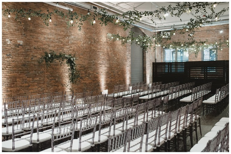 Wedding Ceremony at Axis Pioneer Square in Seattle with greenery on cafe bistro lights and free standing copper ceremony arch | Wedding Planning + Design by Perfectly Posh Events | Photo by CARINA SKROBECKI | #perfectlyposhevents