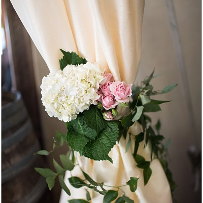 Pink and white flowers with greenery tie back tent draping | Whimsical and Romantic Wedding at DeLille Cellars | Wedding Planning & Design by Perfectly Posh Events | Wedding Photos by Barbie Hull Photography | Wedding Flowers by Floressence | #perfectlyposhevents