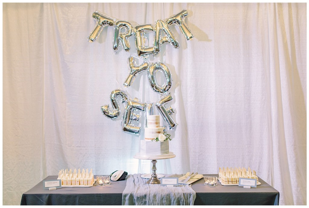 "Elena + Travis brought their personality through in their wedding day with this fun ""Treat Yo Self"" balloon sign at their cake table."