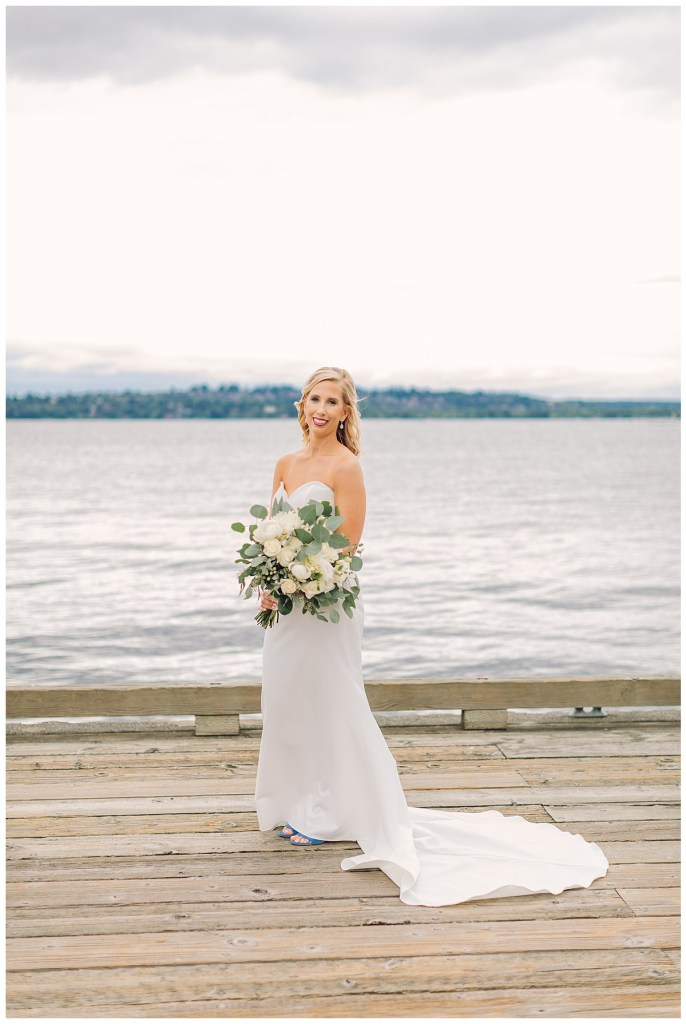 Elena poses on the dock at the Woodmark Hotel & Spa holding her romantic bouquet.