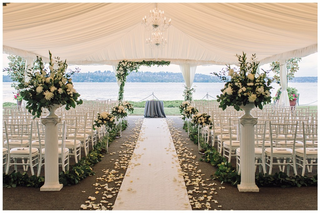 Elena + Travis's wedding ceremony was filled with romantic florals in cream and white tones and lush greenery.