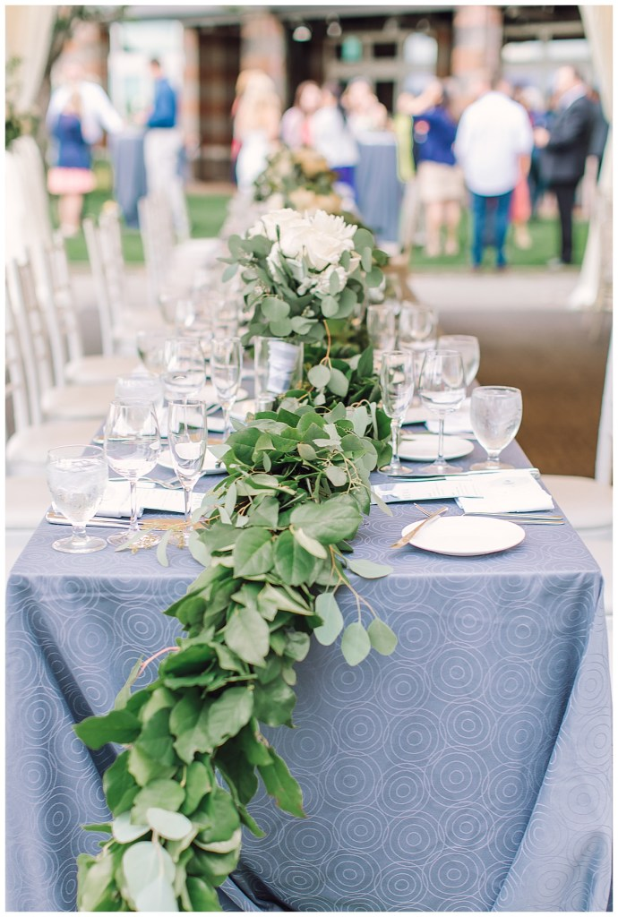 Elena + Travis's reception created visual interest with long tables and round tables, centerpieces that varied in height and lush garland.