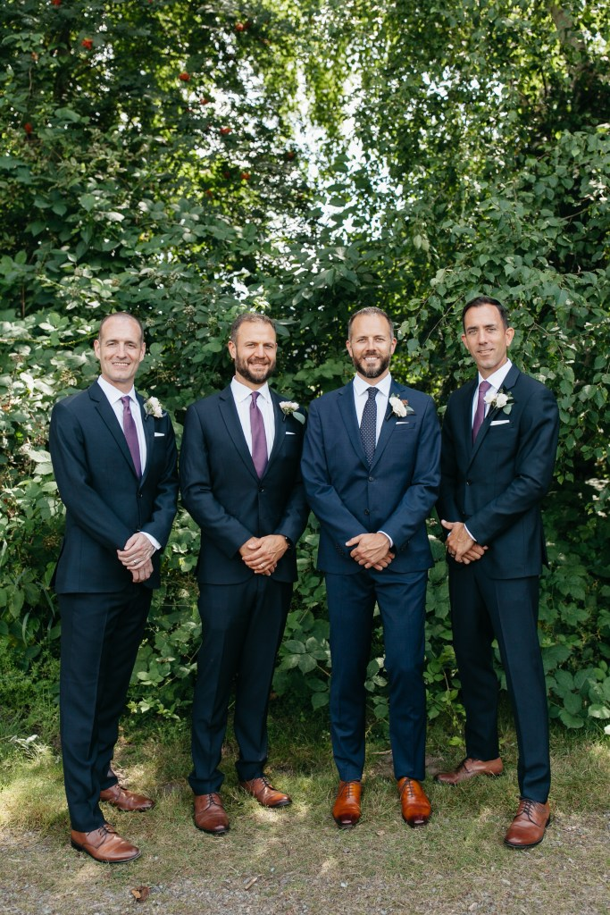 Pantone Color of the Year, Classic Blue, for 2020 is seen here in the groom's wedding day suit as well as his groomsmen's suits.
