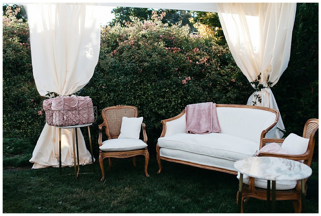 Wedding reception lounge furniture in white and blush.