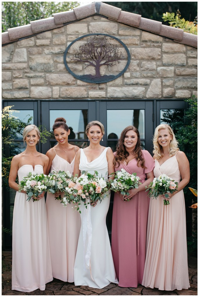 Natural and organic bridesmaid bouquets in blush and white.