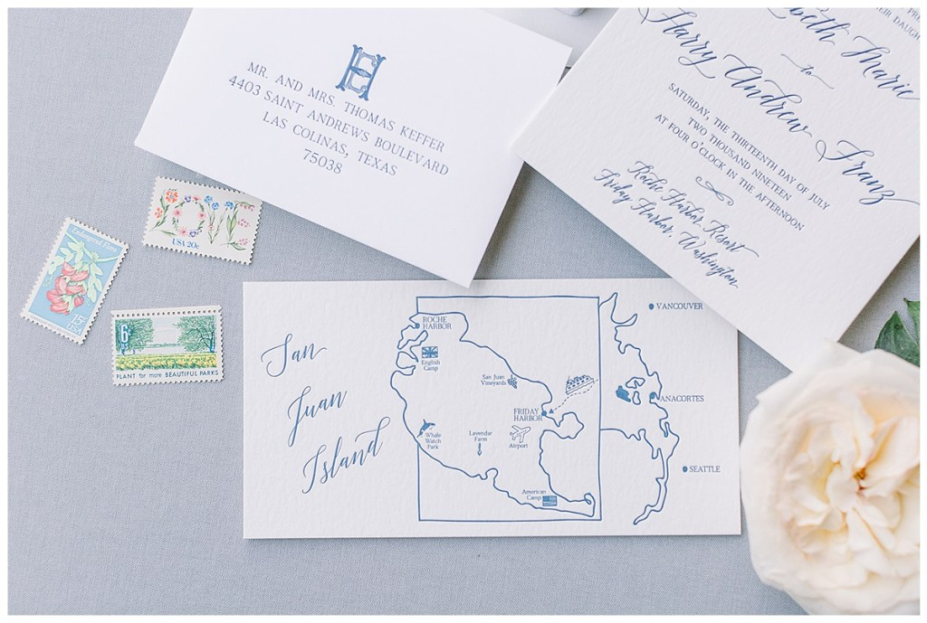 Blue wedding invitation suite with map of wedding venue at Roche Harbor Resort, WA.