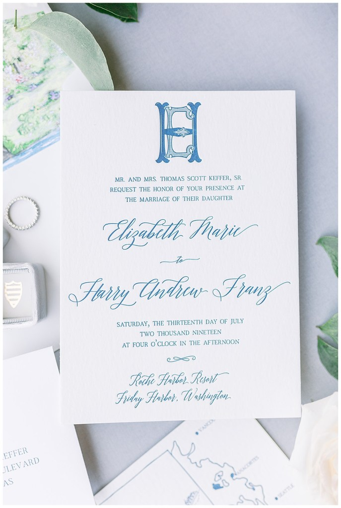 Wedding invitation suite with blue writing and blue monogram.