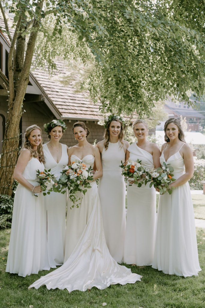 Bride with all white bridesmaids dresses with greenery and white bouquets in Seattle, WA. Wedding planning by Perfectly Posh Events, based in Seattle and Portland. Wedding photography by Kristen Marie Parker Photography. Flowers by Sublime Stems. #perfectlyposhevents