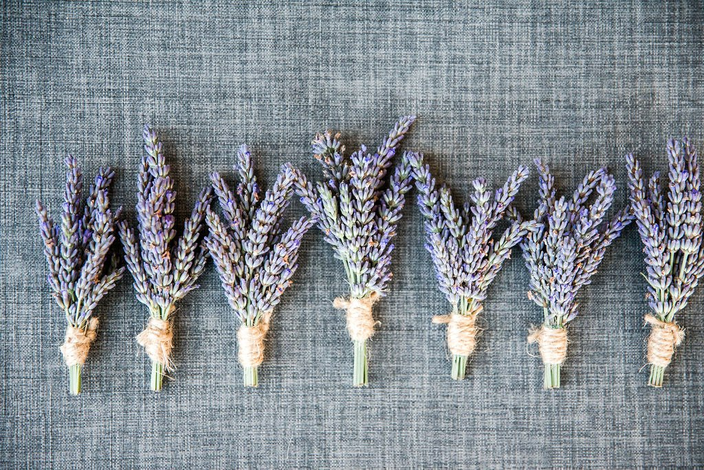 Simple lavender boutonniere for groomsmen. Click for more creative and personal wedding design from this San Juan Island wedding at Roche Harbor Resort in San Juan Island, WA. Wedding planning by Perfectly Posh Events, based in Seattle and Portland. Wedding photography by Lloyd Photographers. Flowers by Bloom San Juan. #perfectlyposhevents