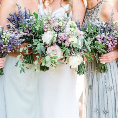 Pale blue and green bridesmaids dresses with lavender and wildflower bouquets. Click for more neutral and pastel chic wedding design from this San Juan Island wedding at Roche Harbor Resort in San Juan Island, WA. Wedding planning by Perfectly Posh Events, based in Seattle and Portland. Wedding photography by Lloyd Photographers. Flowers by Bloom San Juan. Dress by Hayley Paige #perfectlyposhevents